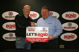 "New Hampshire Motor Speedway vice president and general manager Jerry Gappens (right) and Bond Auto Parts vice president of marketing Mark Mast shake on the deal to make Bond the ""Official Auto Parts Retailer"" at NHMS. (Photo: New Hampshire Motor Speedway)"