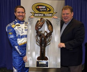 New Hampshire Motor Speedway executive vice president and general manager Jerry Gappens (right) presents 2013 Camping World RV Sales 301 winner Brian Vickers with his Loudon The Lobster Thursday in Charlotte (Photo: New Hampshire Motor Speedway)