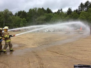 Sprint Cup Series driver Kasey Kahne takes part in firefighter training exercises Wednesday in Concord, N.H. (Photo: New Hampshire Motor Speedway)