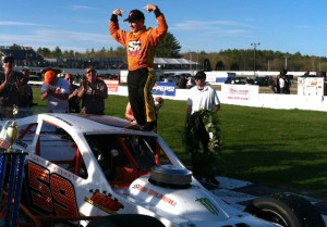 Matt Hirschman salutes the crowd at Lee USA Speedway Sunday after winning the Bullring Bash 100