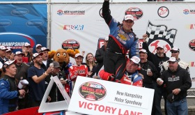 Woody Pitkat celebrates victory in the Whelen Modified Tour F.W. Webb 100 in 2014 at New Hampshire Motor Speedway (Photo: Getty Images)