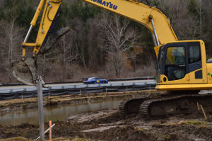 Crews work on a new retention pond behind the newly placed Big Bend inside guardrail at Lime Rock Park (Photo: Lime Rock Park)