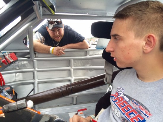 Johnny Walker leans in the car to offer some tips to DARE Stock division rookie Zack Robinson at Stafford Motor Speedway