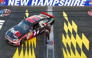 Denny Hamlin poses on the Granite Stripe after coming through on his guarantee to win the 2012 SYLVANIA 300 (Photo: Courtesy of New Hampshire Motor Speedway)