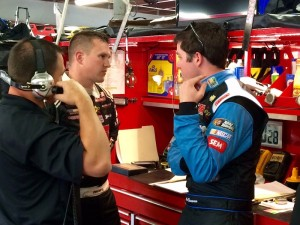 Ryan Preece (middle) talks with Sprint Cup Series driver Alex Bowman (right) following practice for the series Friday at New Hampshire Motor Speedway