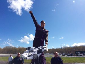 Tony Membrino Jr. celebrates his first career SK Light Modified victory at the New London-Waterford Speedbowl Sunday