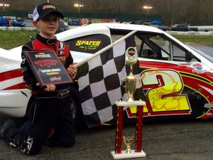 Tyler Barry celebrates victory in the Bandolero feature Saturday at the New London-Waterford Speedbowl