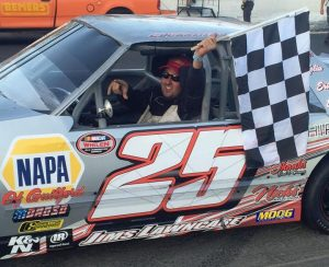 Charles Canfield celebrates victory in the Mini Stock division Saturday at the New London-Waterford Speedbowl (Photo: New London-Waterford Speedbowl)