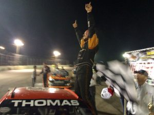 Glen Thomas Jr. celebrates victory in the North East Mini Stock feature Saturday at the New London-Waterford Speedbowl