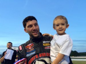 Keith Rocco celebrates his SK Modified victory Wednesday at Thompson Speedway with his son K.J.