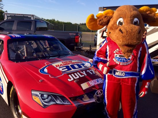 New Hampshire Motor Speedway mascot Milo the Moose kept guard over the track's show car Thursday
