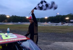 Corey Barry celebrates victory Saturday at the New London-Waterford Speedbowl