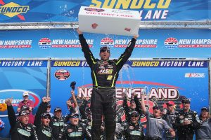 Doug Coby celebrates victory in the Whelen Modified Tour New England 100 Saturday at New Hampshire Moor Speedway. (Photo: Sarah Crabill/Getty Images for NASCAR)