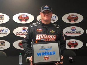 Ron Silk celebrates his pole winning effort Saturday at New Hampshire Motor Speedway