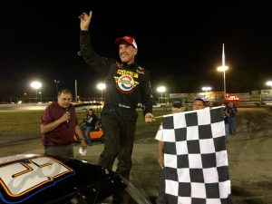Ted Christopher celebrates victory in the SK Modified division Saturday at the New London-Waterford Speedbowl
