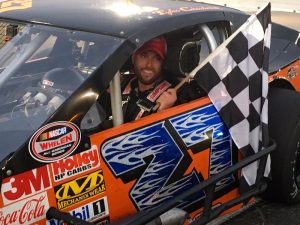 Tyler Chadwick celebrates victory in the SK Modified feature Saturday at the New London-Waterford Speedbowl