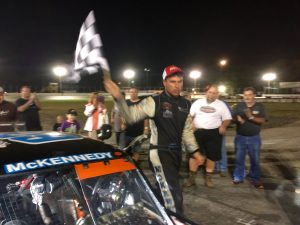 Jon McKennedy celebrates victory at the New London-Waterford Speedbowl Saturday