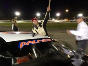 Jason Palmer celebrates victory in the Late Model feature Saturday at the New London-Waterford Speedbowl