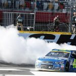 Jimmie Johnson celebrates victory following the Sprint Cup Series Bank of America 500 at Charlotte Motor Speedway Sunday (Photo: Jerry Markland/Getty Images for NASCAR)