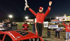 Matt Hirschman celebrates victory in the NorthEast Race Cars & Parts Tri-Track Open Modified Series event Sunday at the New London-Waterford Speedbowl