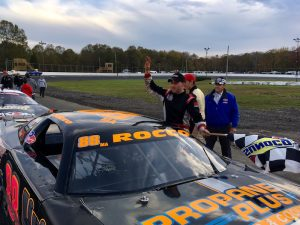 Keith Rocco celebrates a Late Model victory and division championship Saturday at the New London-Waterford Speedbowl