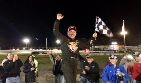 Ted Christopher celebrates victory in the SK Modified feature Sunday at the New London-Waterford Speedbowl