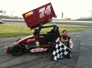 Doug Coby celebrates his first career Northeastern Midget Association victory at Seekonk Speedway last June with Bertrand Motorsports