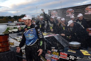 Doug Coby is showered by his team after winning his second Whelen Modified Tour championship (Photo: Getty Images for NASCAR)