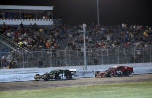 Matt Hirschman (52) chases race winner Justin Bonsignore to the checkered in a Whelen Modified Tour event last August at Thompson Speedway (Photo: Darren McCollester/Getty Images for NASCAR)