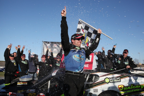 Doug Coby celebrates victory in the Whelen Modified Tour season opening Icebreaker 150 April 12, 2015 at Thompson Speedway (Photo: Tim Bradbury/Getty Images for NASCAR)