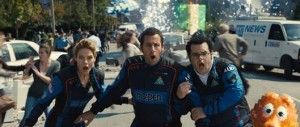 """Adam Sandler (middle), who stars with Josh Gad (right) and Michelle Monaghan (left) in this summer's action-comedy """"Pixels"""", will serve as Grand Marshal for the NASCAR Sprint Cup Series event at NHMS on July 19 . (Photo: Courtesy Sony Pictures/NHMS)"""