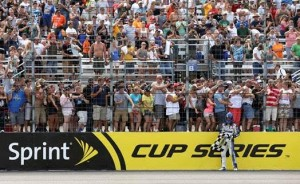 Brian Vickers celebrated with fans on the frontstretch after winning the 2013 Camping World RV Sales 301 at New Hampshire Motor Speedway (Photo: Courtesy of New Hampshire Motor Speedway)