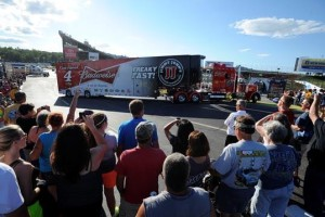 Fans watch the NASCAR Sprint Cup Series Hauler Parade last July at New Hampshire Motor Speedway. This year's parade will run on Thursday, July 16 at 6 p.m. and will begin next to the NHMS Fan Zone. (Photo: Courtesy New Hampshire Motor Speedway)