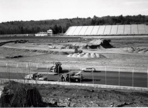 Construction workers survey the backstretch of New Hampshire International Speedway during construction of the racetrack in August of 1989 (Photo: Courtesy of New Hampshire Motor Speedway)