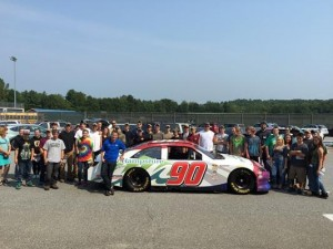 A.J. Allmendinger poses for a picture with students at The Center for Technology in Essex, Vt., on Wednesday during his Victory Tour visit to the Green Mountain State. (Photo: Courtesy of New Hampshire Motor Speedway)
