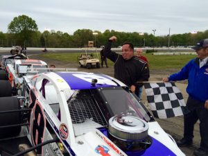 Diego Monahan celebrates victory in the first of two SK Modified features Saturday at the New London-Waterford Speedbowl