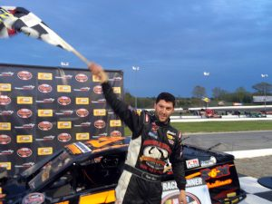 Keith Rocco celebrates victory in the SK Modified division Wednesday at Thompson Speedway