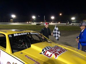 Monte Gibbs celebrates victory in the Limited Sportsman feature Saturday at the New London-Waterford Speedbowl