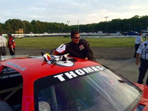 Bruce Thomas Jr. celebrates victory in the Late Model feature Saturday at the New London-Waterford Speedbowl