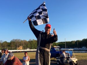 Joey Gada celebrates victory in the first SK Modified feature of the night Saturday at the New London-Waterford Speedbowl