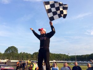 Tony Membrino celebrates his SK Light Modified victory Sunday at the New London-Waterford Speedbowl