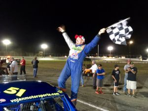 Rob Janovic Jr. celebrates victory in the SK Modified feature Saturday at the New London-Waterford Speedbowl