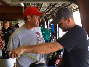 Ryan Stone and Bobby Santos III chat before the start of Wednesday's Whelen Modified Tour test session at New Hampshire Motor Speedway