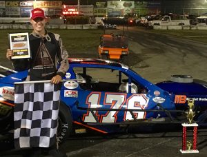 Cory DiMatteo celebrates his first SK Light Modified victory Saturday at the New London-Waterford Speedbowl