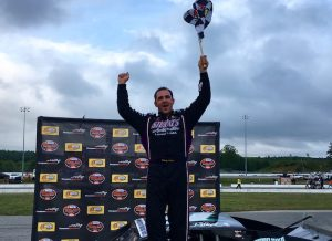 Woody Pitkat celebrates victory in the SK Modified feature Wednesday at Thompson Speedway
