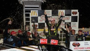 Doug Coby celebrates victory Saturday in the NASCAR Whelen Modified Tour event at Oswego Speedway (Photo: NASCAR/Fran Lawlor)
