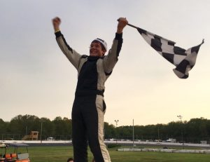 Jacob Perry celebrates his second consecutive Mini Stock victory Saturday at the New London-Waterford Speedbowl