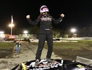 Tony Membrino Jr. celebrates the SK Light Modified win and championship Saturday at the New London-Waterford Speedbowl